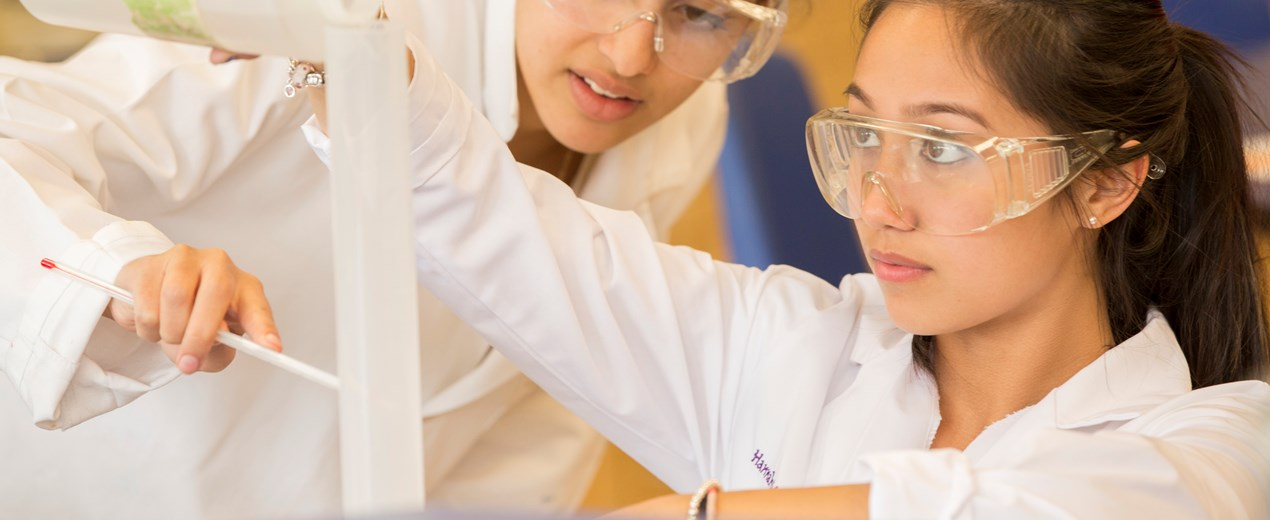 A female student works in a science lab