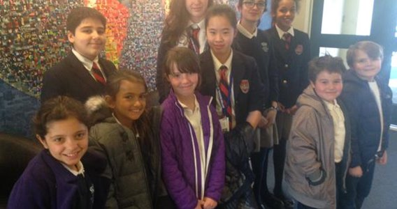 Students pose in the British International School of Boston lobby